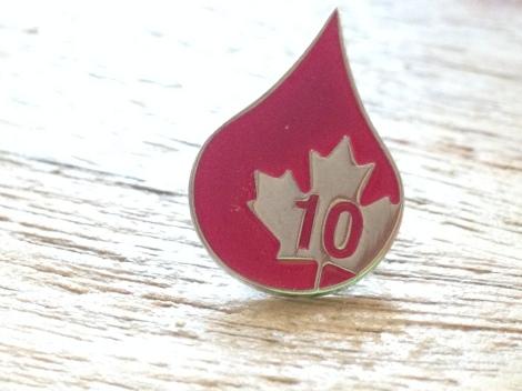 Écusson de la Société canadienne du sang.